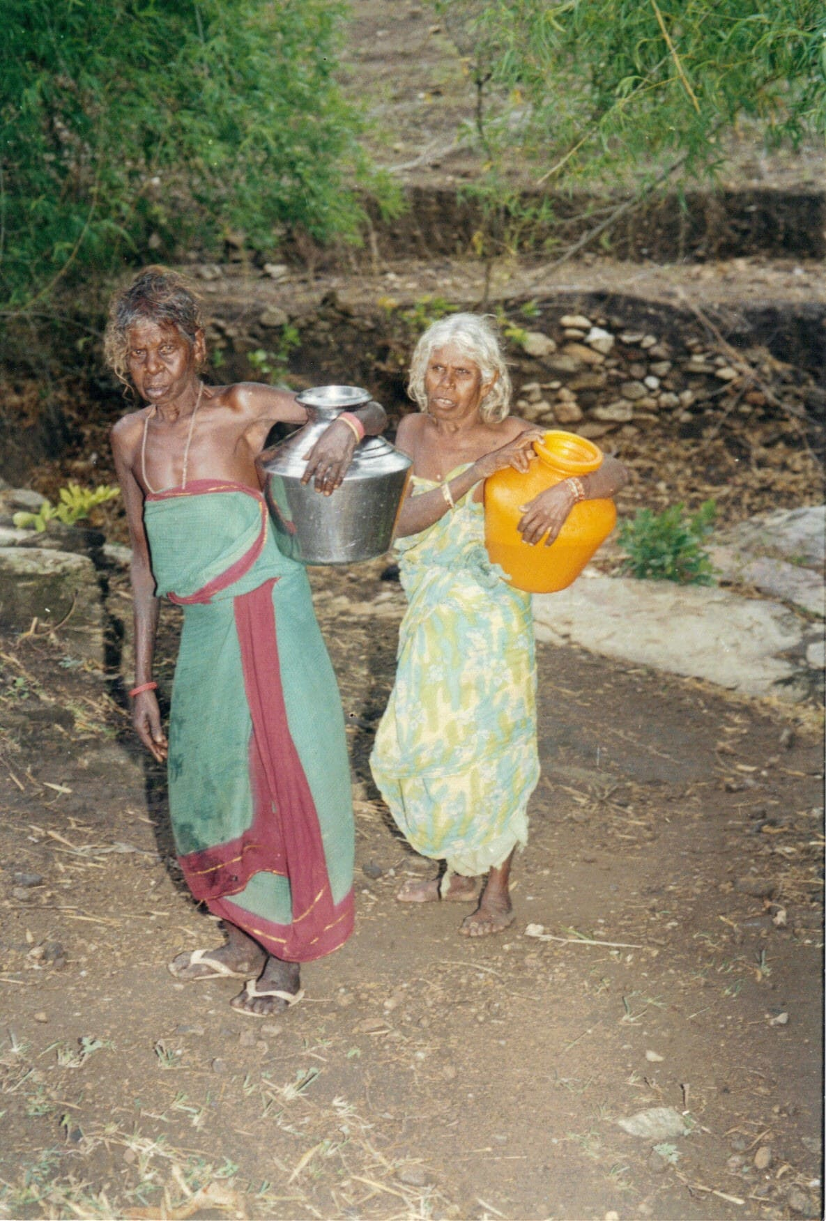 Tribal woment carrying water